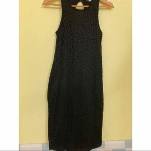 Mid length black crochet dress. Size Sm.